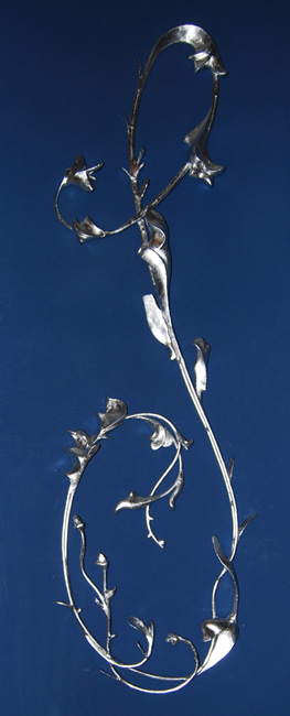 In memorium: Ess, a fabricated steel and silver leaf sculpture. Metal artwork by Andrew Miguel Fuller. AM Andy Fuller