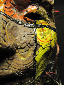 Catya II sculpture by AM Andy Fuller, Andrew Miguel Fuller. Assemblage art, bottle cap artwork with hammered copper