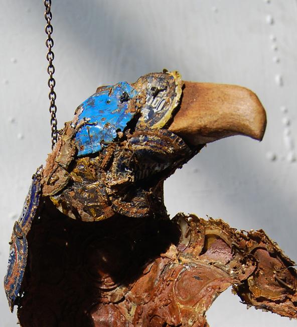 Persistence. Hanging sculpture by AM Andy Fuller. Bottle cap assemblage art artwork. Andrew Miguel Fuller sculpture