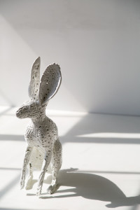 All white rabbits are made of porcelain. Powder coated metal sculpture by AM Fuller. Andrew Miguel Fuller contemporary fine art
