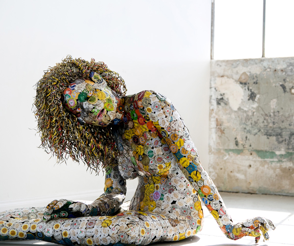 Siting nude fine art sculpture by AM Andy Fuller. Andrew Miguel Fuller contemporary assemblage artwork. Found objects sewn together with steel wire.