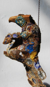 Persistence. Hanging sculpture by AM Andy Fuller. Bottle cap assemblage art artwork. Andrew Miguel Fuller sculpture