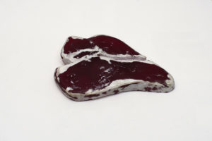 Resin sculpture titled after Ravi Shankar song, West eats meat, by Andrew Miguel Fuller. Dyed resin by AM Andy Fuller