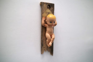 Baby on board, an assemblage art sculpture by Andrew Miguel Fuller. Found object artwork by Andy AM Fuller