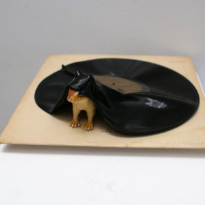 Assemblage art sculpture by Andrew Miguel Fuller. Gimme shelter, a found object artwork by Andy AM Fuller