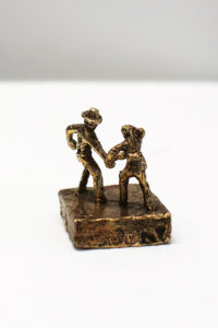 Bronze artwork by Andrew Miguel Fuller. Aggressive handshake, an absurd cowboy sculpture by AM Andy Fuller