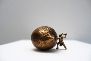 Bronze artwork by Andrew Miguel Fuller. Western man strikes gold, an absurd cowboy sculpture by AM Andy Fuller