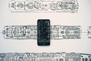 RMS Titanic and iPhone is an assemblage sculpture by AM Fuller. Drawing and sculpture by Andrew Miguel Fuller.