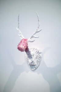 Trophy is a resin crystal and metal sculpture by Andrew Miguel Fuller. Mounted stag artwork by AM Fuller.